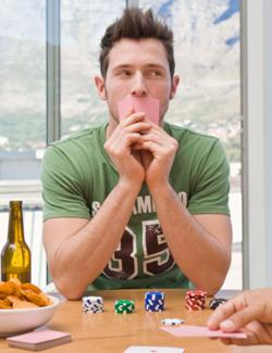 Young man playing poker.