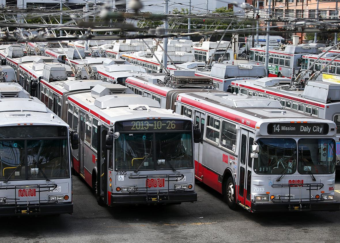 San Francisco Municipal Transit Agency buses sit idle at the MUNI Potrero Division Yard on June 3, 2014 in San Francisco, California.