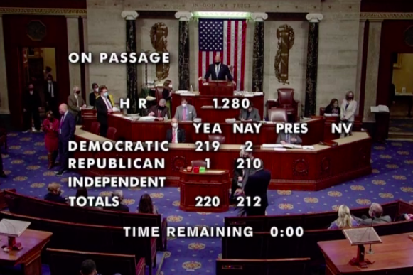 A tally of each party's votes on the bill is overlaid onto background footage of the House floor.