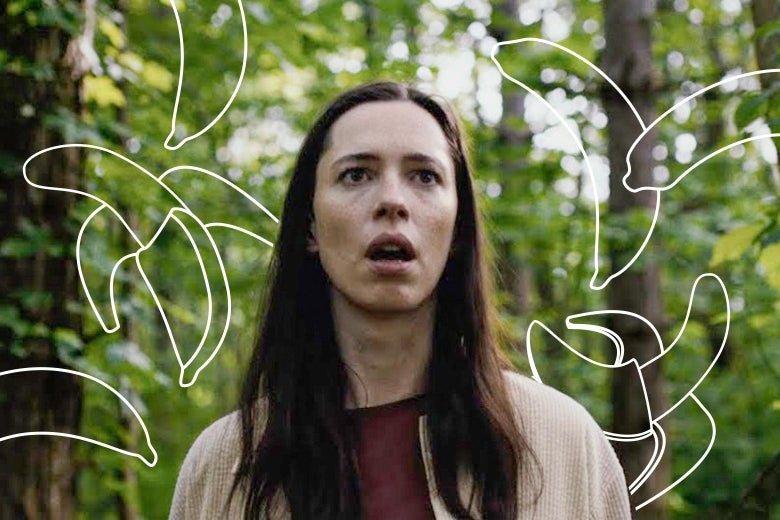Rebecca Hall walks through a forest with a confused expression on her face, in a still from The Night House. Around her head, white outlines of bananas have been drawn onto the photograph.