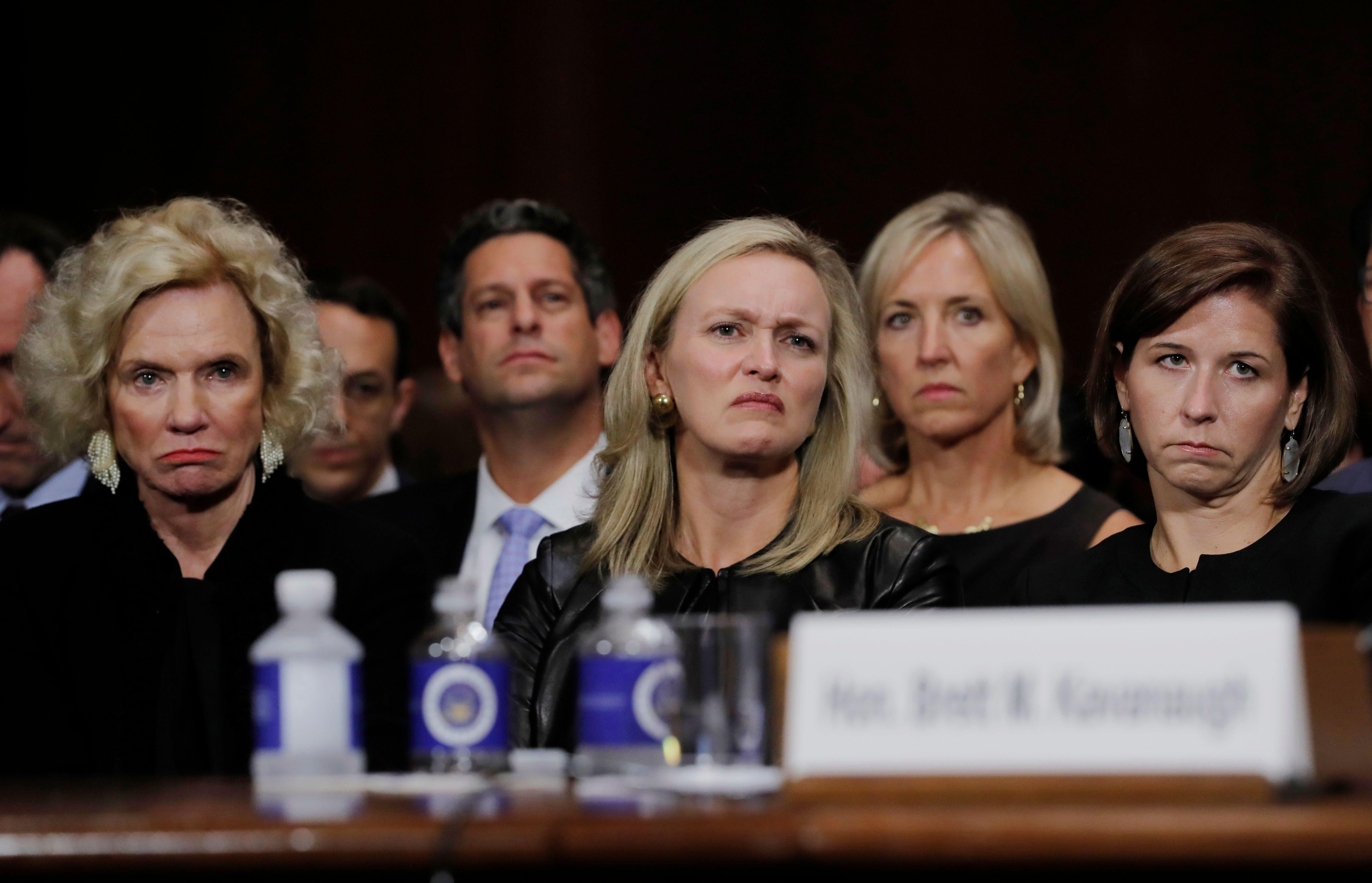 (L-R) Martha Kavanaugh, Laura Cox Kaplan, and Ashley Kavanaugh, listen as Judge Brett M. Kavanaugh testifies in front of the Senate Judiciary committee regarding sexual assault allegations at the Dirksen Senate Office Building on Capitol Hill on September 27, 2018 in washington,DC. - University professor Christine Blasey Ford, 51, told a tense Senate Judiciary Committee hearing that could make or break Kavanaugh's nomination she was '100 percent' certain he was the assailant and it was 'absolutely not' a case of mistaken identify. (Photo by JIM BOURG / POOL / AFP)        (Photo credit should read JIM BOURG/AFP/Getty Images)