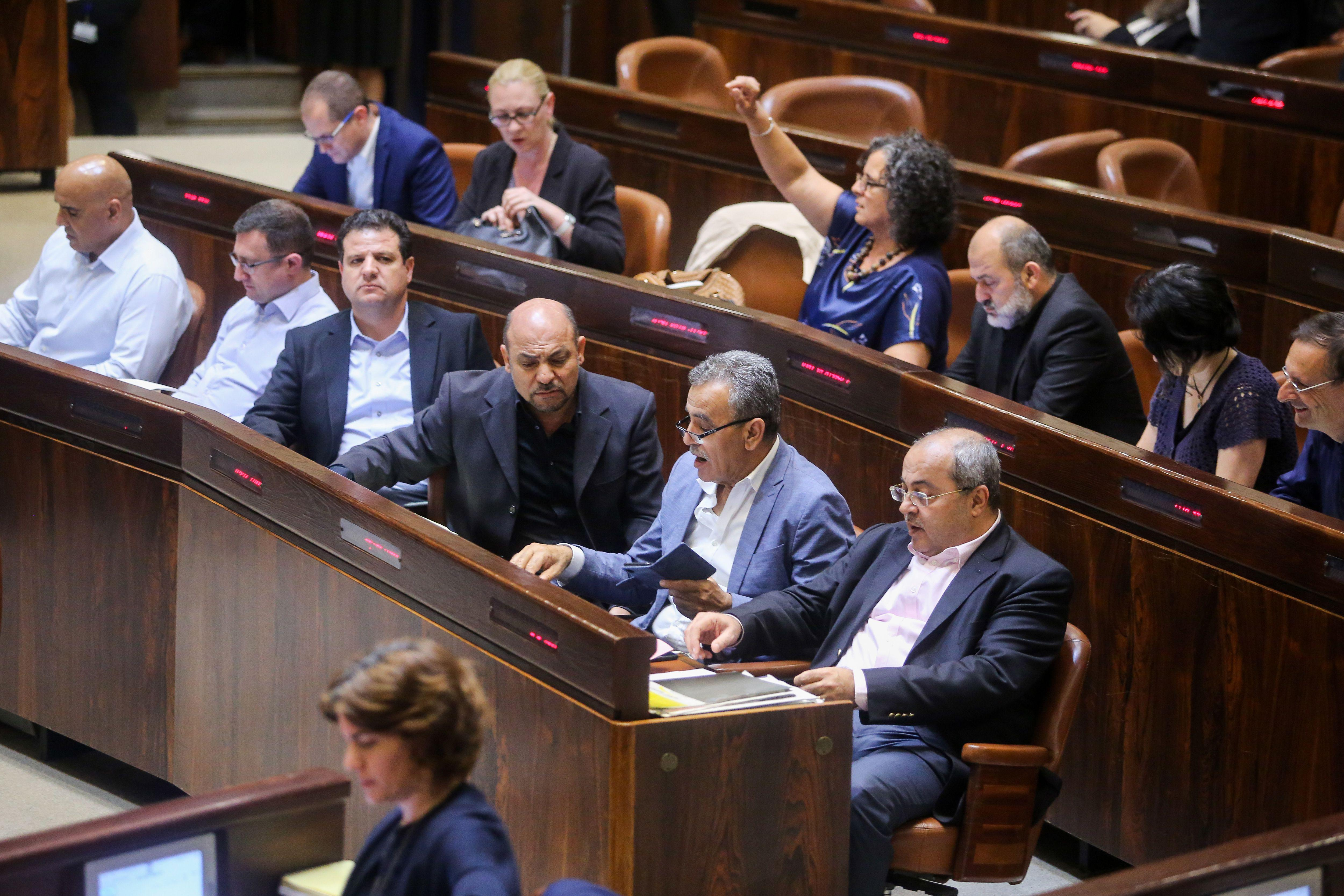 Members of the Israeli parliament sit in the Knesset.