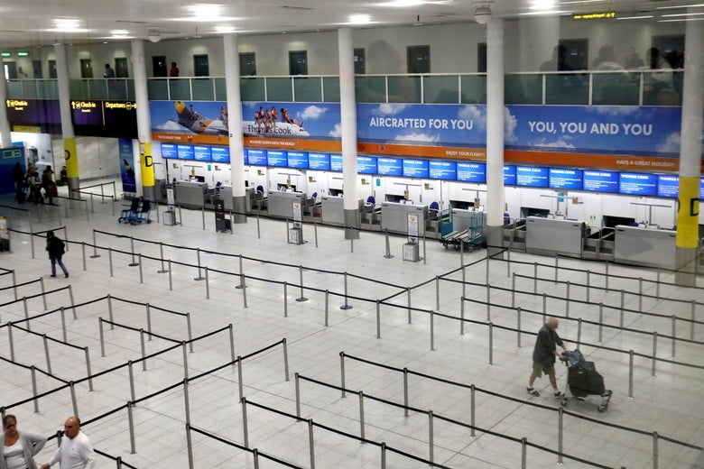 Closed Thomas Cook check-in desks at Gatwick Airport.