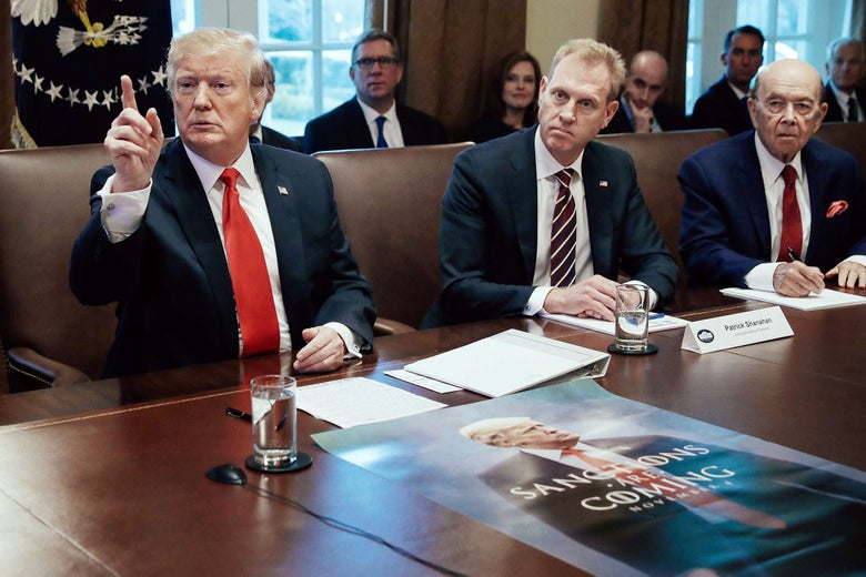 Donald Trump, Patrick Shanahan, and Wilbur Ross at a table in the White House.