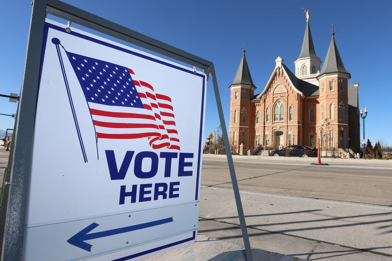 A temple of the Church of Jesus Christ of Latter Day Saints sits actress the street from a polling center for the midterm elections on November 6, 2018 in Provo, Utah.
