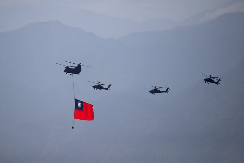 Four military helicopters are seen flying, with the leftmost chopper carrying a Taiwan flag.