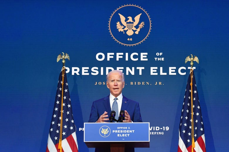 """Joe Biden on stage in front of the words """"The Office of the President-Elect."""""""
