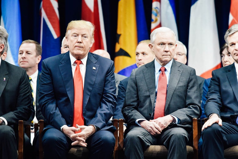President Donald Trump sits with Attorney General Jeff Sessions on Dec. 15 in Quantico, Virginia, before participating in the FBI National Academy graduation ceremony.
