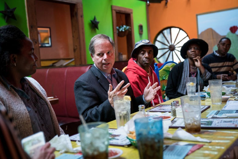 Doug Jones at a restaurant in Talladega, Alabama with voters.