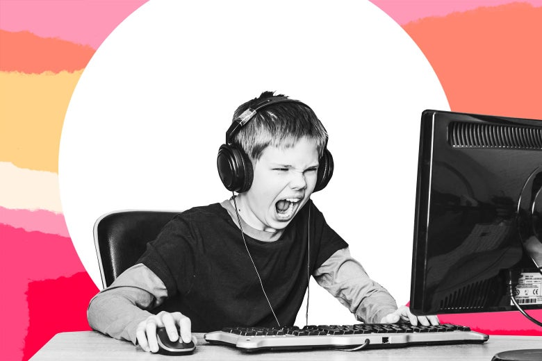 A kid with headphones on yelling at a computer screen.