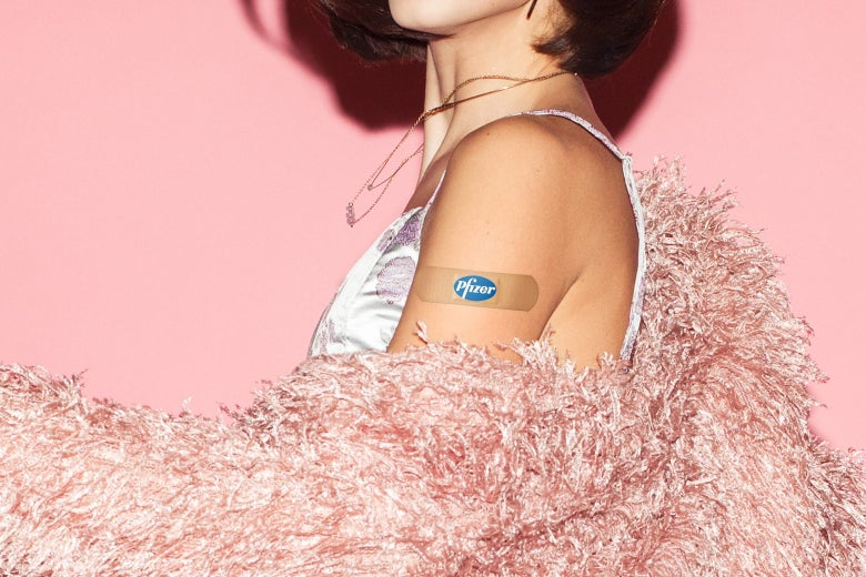 A glamorous woman with a bandage on her upper arm that says Pfizer.