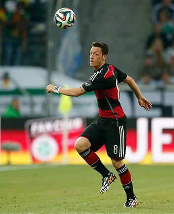 Mesut Özil runs with the ball during a friendly against Cameroon on June 1, 2014, in Moenchengladbach, Germany.