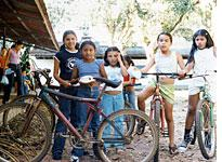 Schoolchildren meet in front of the dining hall after school to go for a bike ride