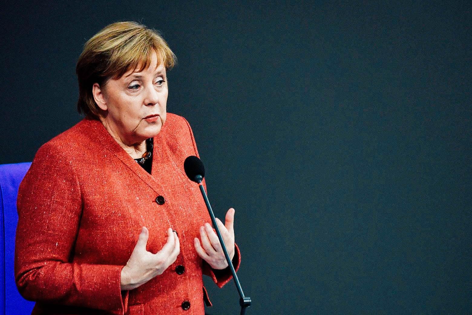 German Chancellor Angela Merkel answers questions on Dec. 12 in Berlin.