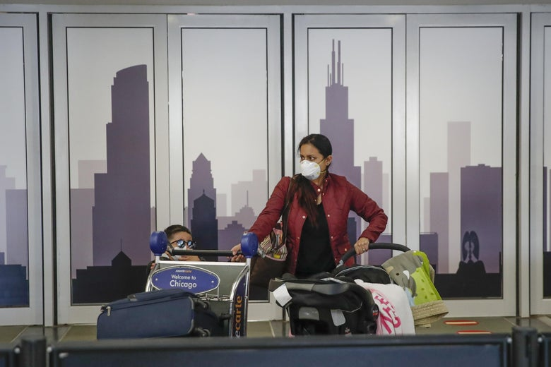 Travelers arrive at the international terminal of the O'Hare Airport in Chicago, Illinois, on March 13, 2020.