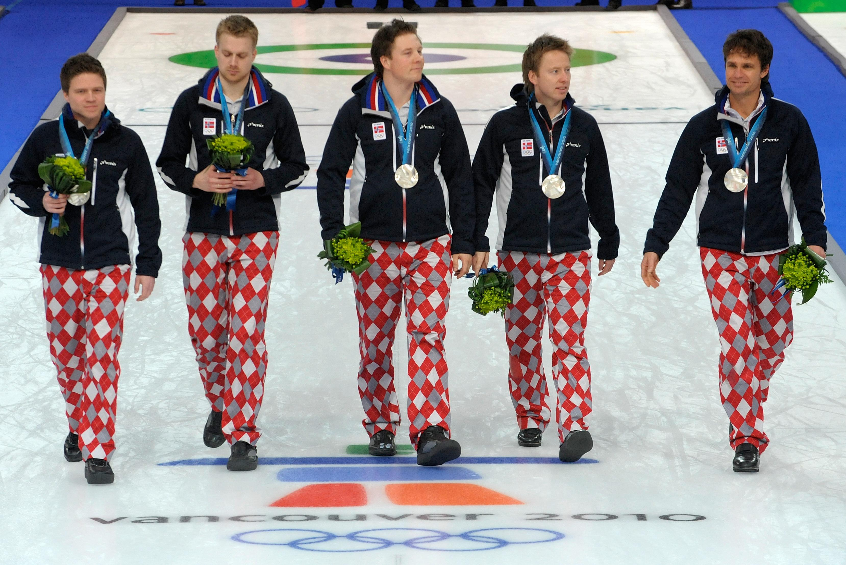 Silver medal winner Norway team, (L-R) Thomas Loevold, Haavard Vad Petersson, Christoffer Svae, Torger Nergaard and Thomas Ulsrud march on the sheet during the medal presentation ceremony after their Vancouver Winter Olympics men's curling gold medal match at the Vancouver Olympic Centre, on February 27, 2010.    AFP PHOTO / TOSHIFUMI KITAMURA (Photo credit should read TOSHIFUMI KITAMURA/AFP/Getty Images)