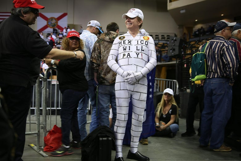 Steve Travers dressed as a wall waits for the arrival of Donald Trump to speak at the CFE Arena during a campaign stop on the campus of the University of Central Florida on March 5, 2016 in Orlando, Florida.