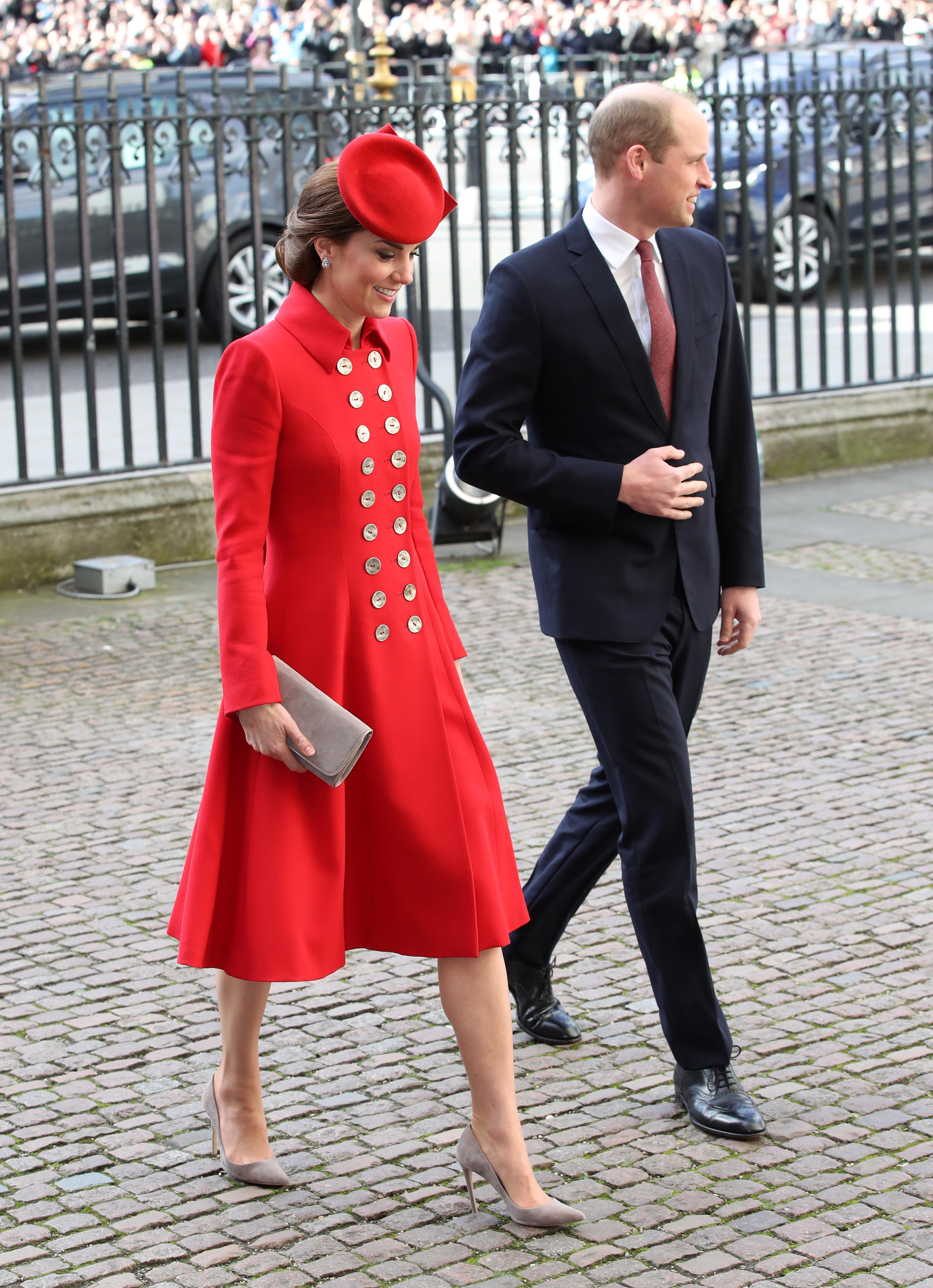 Kate Middleton and Prince William walk into Westminster Abbey.