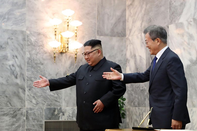 In this handout image provided by South Korean Presidential Blue House, South Korean President Moon Jae-in (R) walks with North Korean leader Kim Jong-un (L) during their meeting on May 26, 2018 in Panmunjom, North Korea.