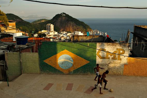 Children play soccer at a square at a favela in Rio de Janeiro February 22, 2013.