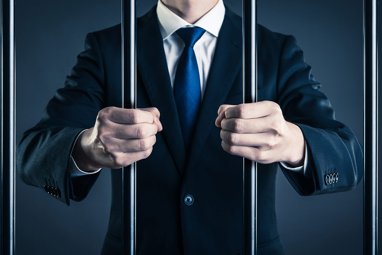 Suited executive behind bars