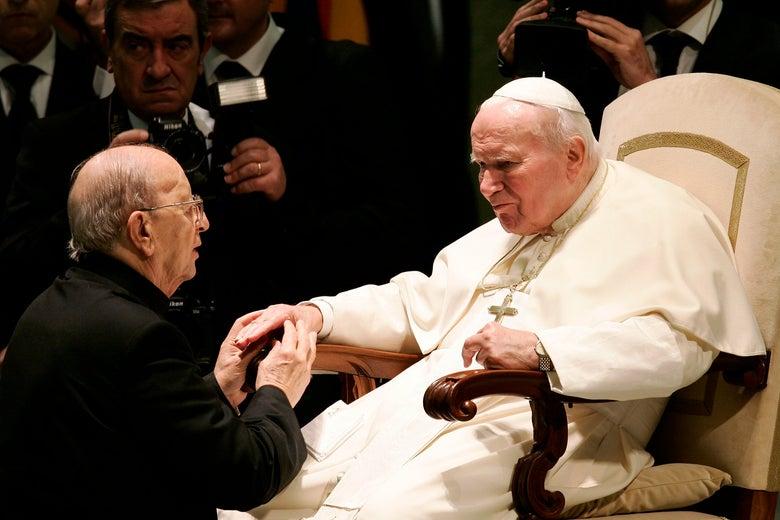 Marical Maciel holds the hand of Pope John Paul II.