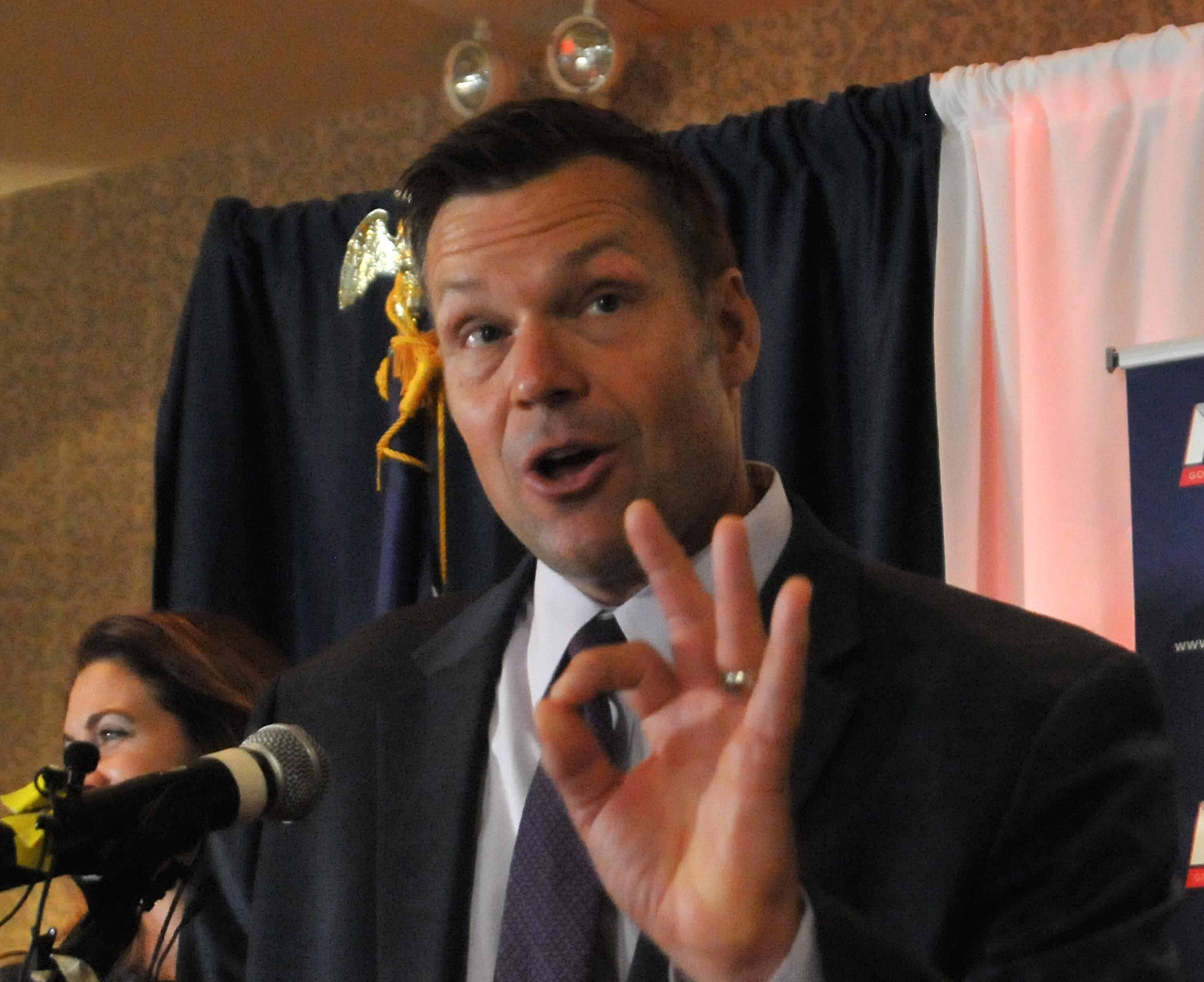 Kris Kobach speaks to supporters just after midnight on Tuesday as his primary remained too close to call.