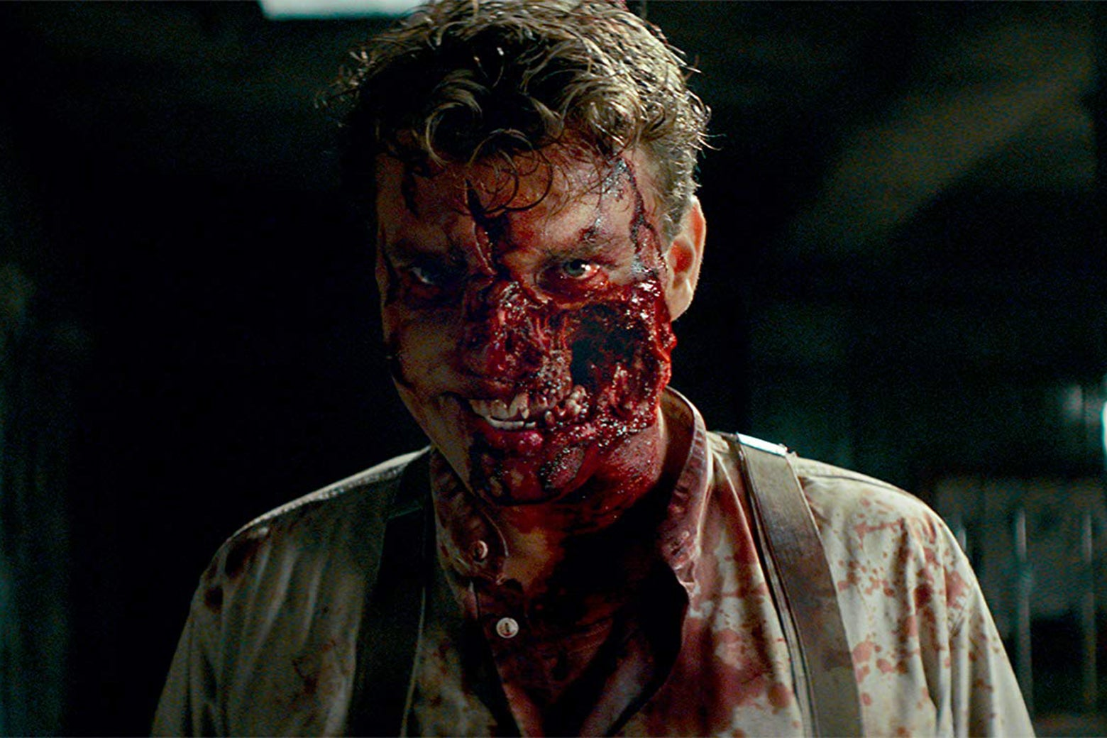 Actor Pilou Asbæk in a still from Overlord in which he is playing a Nazi zombie with half his face blown off.