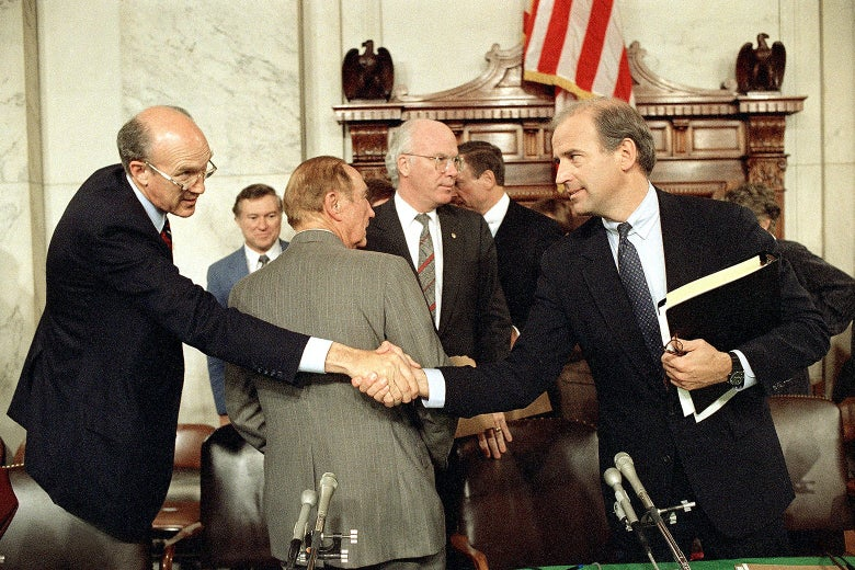 Biden shakes hands with Simpson in the committee room
