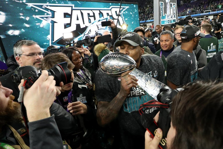 Philadelphia Eagles players kiss the Lombardi Trophy after defeating the New England Patriots in Super Bowl LII on Feb. 4, 2018 in Minneapolis, Minnesota.