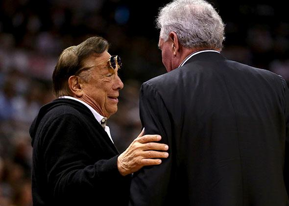 Team owner Donald Sterling of Los Angeles Clippers talks with team owner Peter Holt of the San Antonio Spurs.