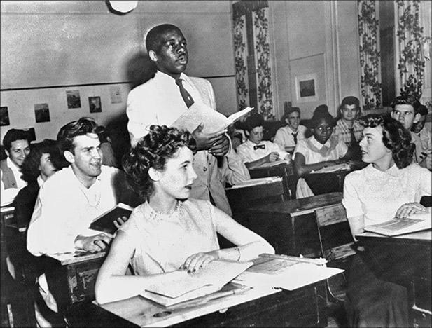 Nathaniel Steward, 17, recites his lesson surrounded by other black students, May 21, 1954, at the Saint-Dominique school, in Washington, where for the first time in USA the Brown v. Board.