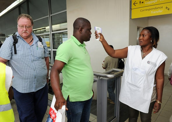 Patients are screened for fever at an airport in the Ivory Coast.