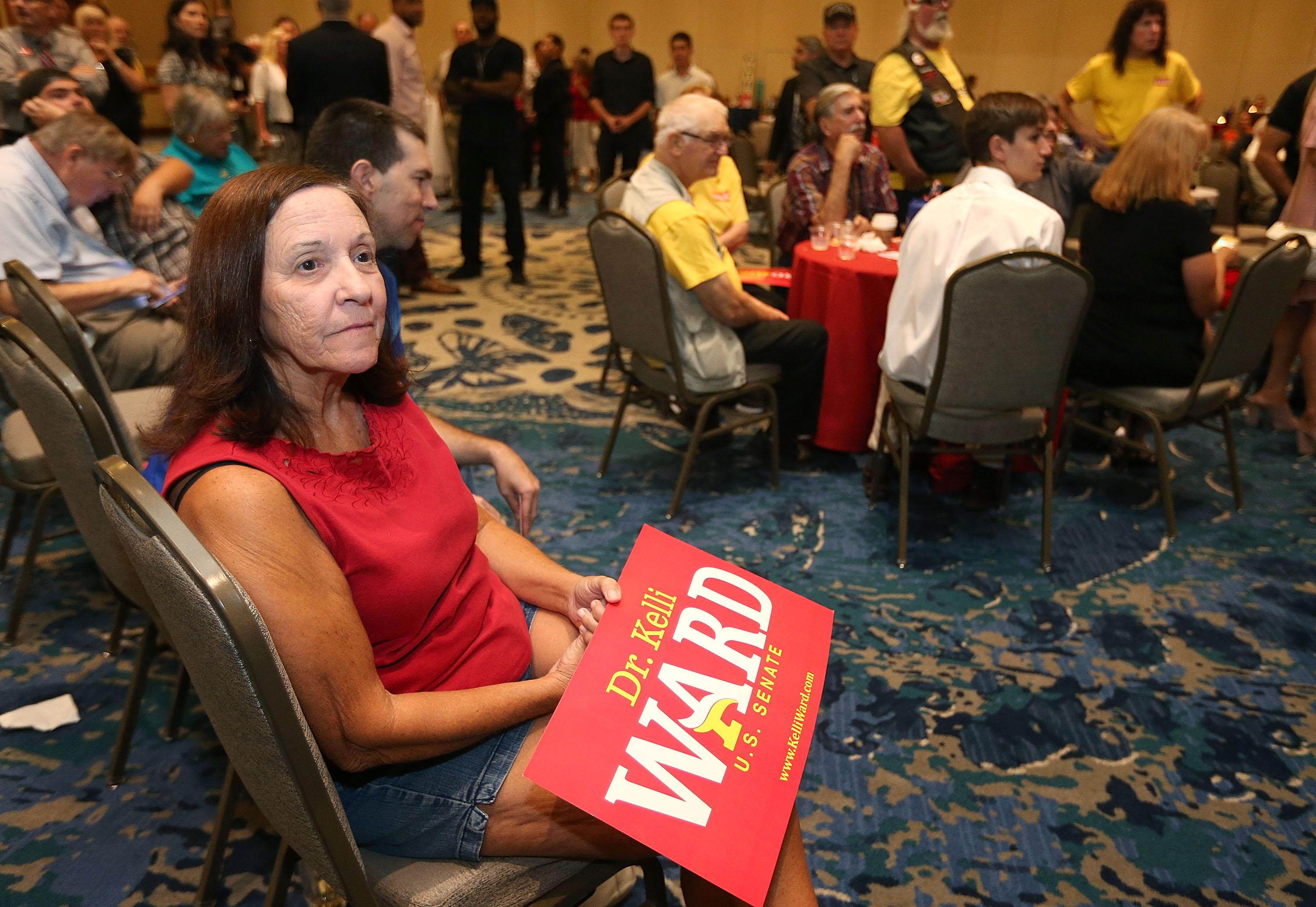 SCOTTSDALE, AZ - AUGUST 28:  A campaign supporter for Arizona GOP Senate candidate Kelli Ward watches results at an election night event in which Ward conceded the race on August 28, 2018 in Scottsdale, Arizona.  Former state Sen. Ward, U.S. Rep. Martha McSally and former Maricopa County Sheriff Joe Arpaio were vying to replace outgoing Sen. Jeff Flake (R-AZ).  (Photo by Ralph Freso/Getty Images)