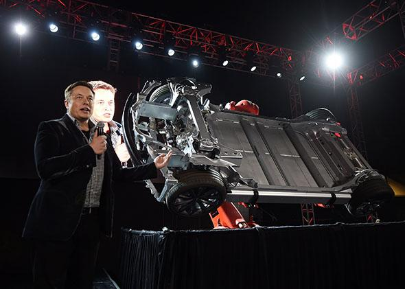 Tesla founder and chief executive Elon Musk unveils the new Tesla 'D' model in Los Angeles on October 9, 2014.
