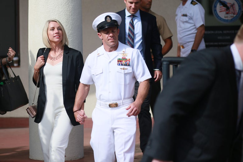 Navy Special Operations Chief Edward Gallagher celebrates with his wife Andrea after being acquitted of premeditated murder at Naval Base San Diego July 2, 2019 in San Diego, California.