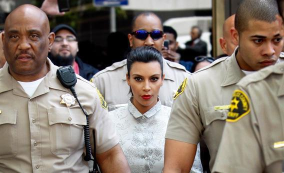 Kim Kardashian surrounded by Los Angeles County Sheriff Deputies leaves the Stanley Mosk Courthouse after attending her divorce hearing from Kris Humphries.