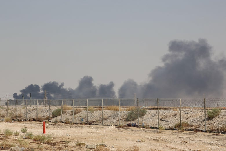 Smoke billows from an Aramco oil facility in Abqaiq about 37 miles southwest of Dhahran in Saudi Arabia's eastern province on September 14, 2019.
