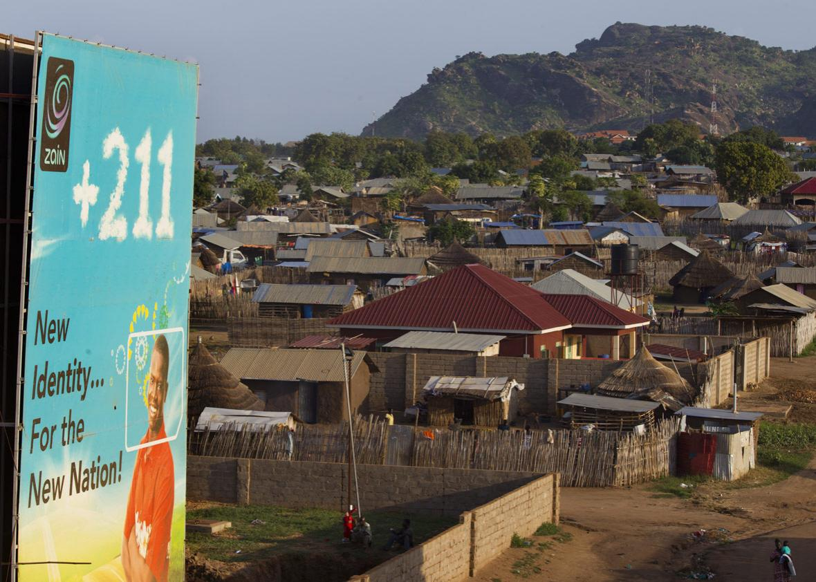 A mobile telephone company billboard is seen in a neighborhood of the capitol city July 19, 2012 in Juba, South Sudan.