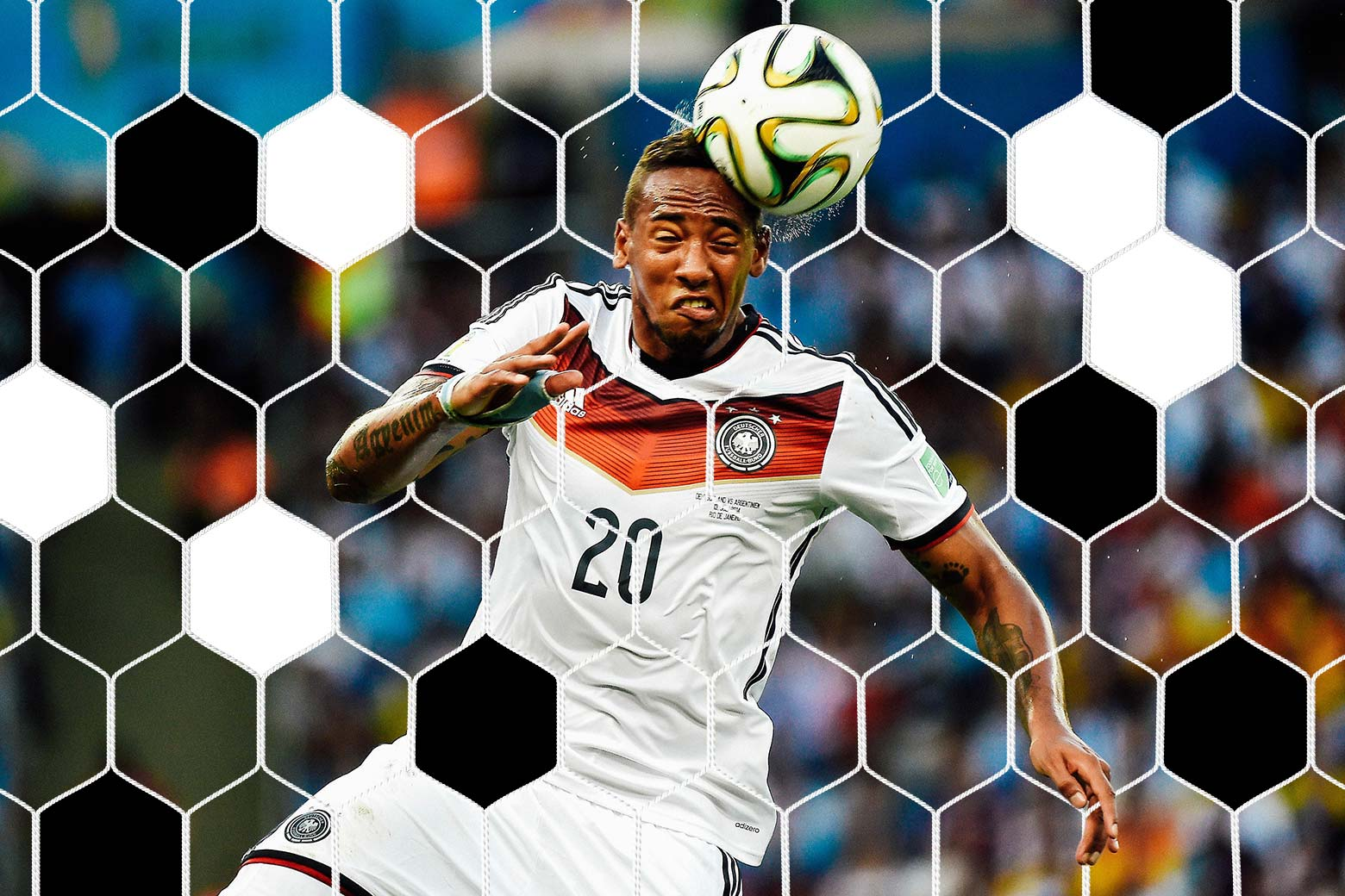 Jerome Boateng grimaces as he heads the ball.