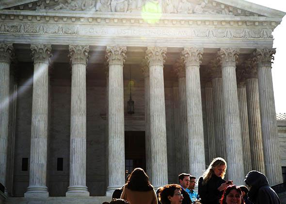 A line forms to enter the U.S. Supreme Court for oral arguments on April 22, 2014, in Washington, D.C.