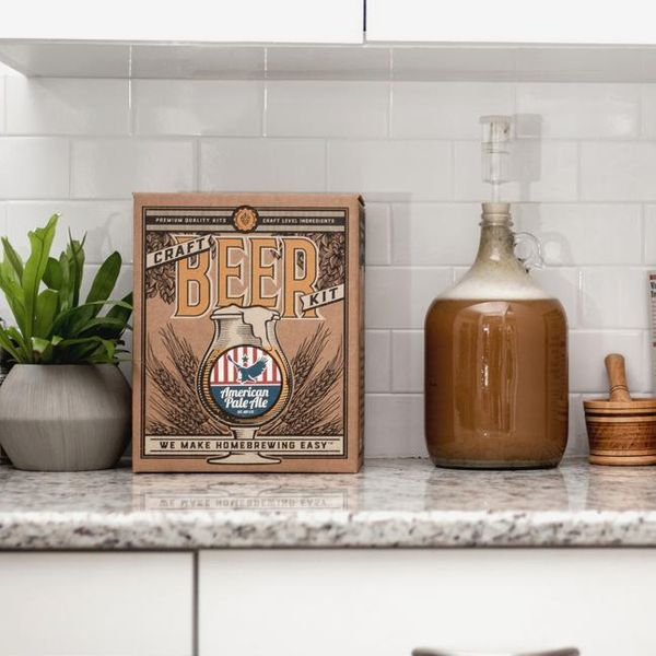 Beer Brewing Kit in White House Honey Ale on a kitchen counter