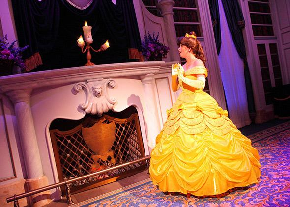 Belle speaks with Lumière during Enchanted Tales With Belle in new Fantasyland