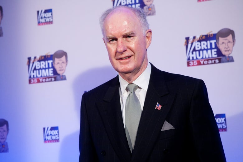 Thomas McInerney in front of Fox News logos at a red-carpet event.