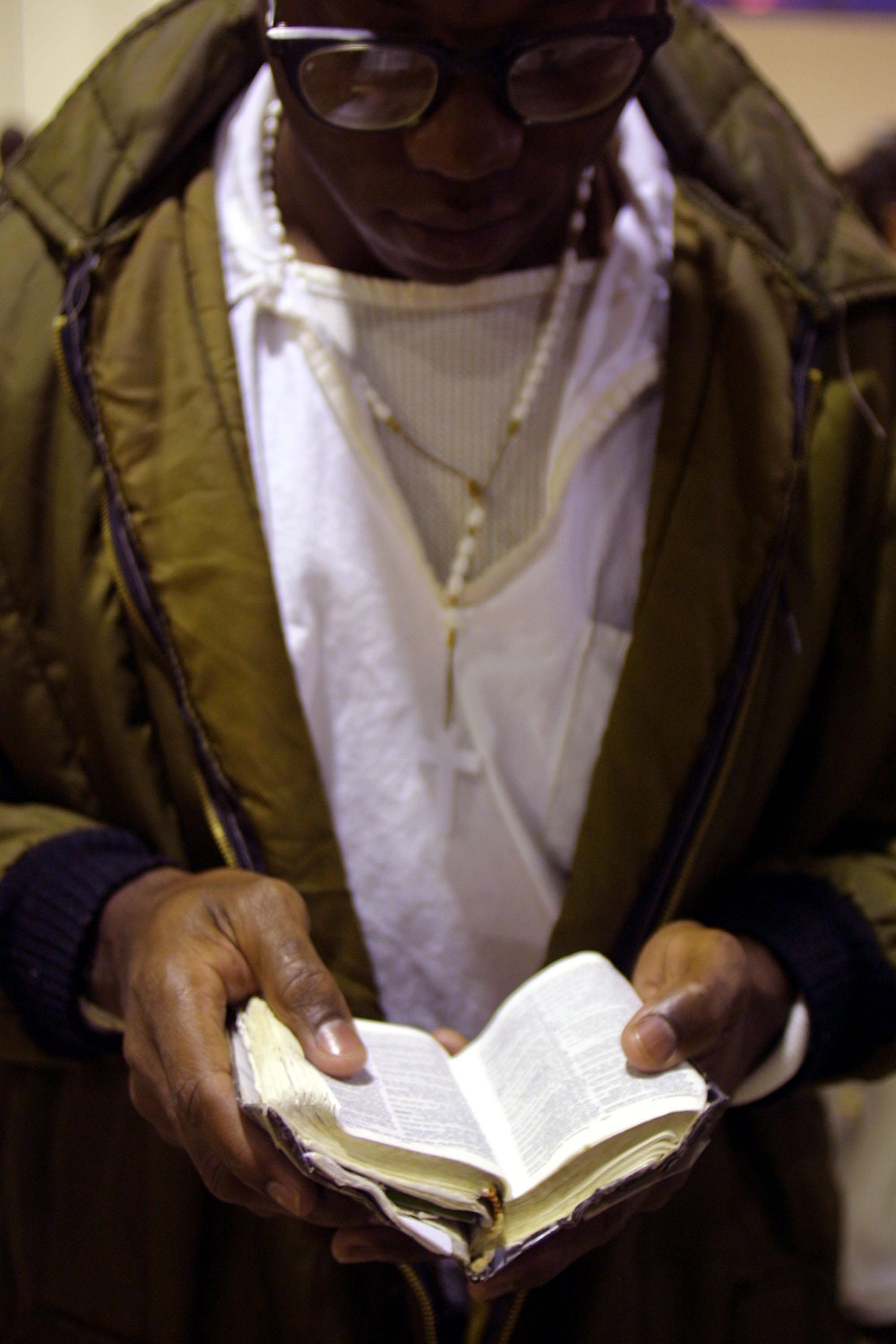 An inmate reads his bible.
