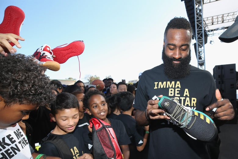 LOS ANGELES, CA - JUNE 24:  James Harden signs autographs at 'Imma Be a Star' Block Party at Audubon Middle School on June 24, 2018 in Los Angeles, California.  (Photo by Phillip Faraone/Getty Images for adidas)