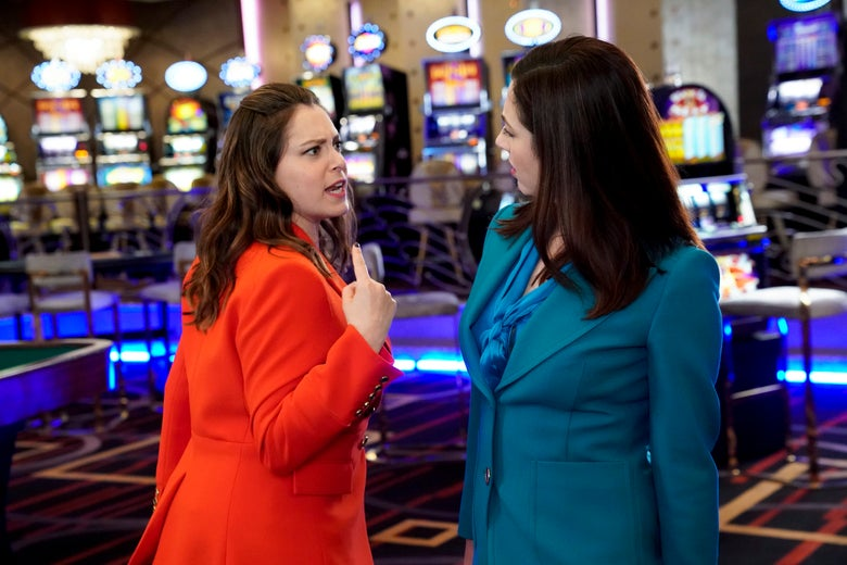 Rachel Bloom and Rachel Grate face off in a casino wearing colorful pantsuits.