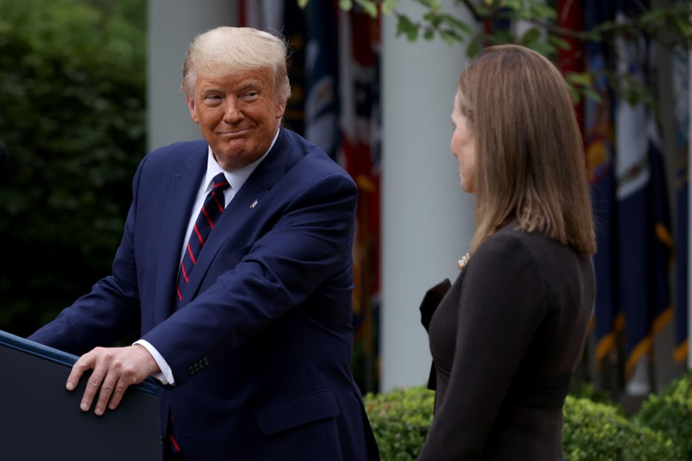 Donald Trump looks at Amy Coney Barrett as he nominates her to serve on the Supreme Court.
