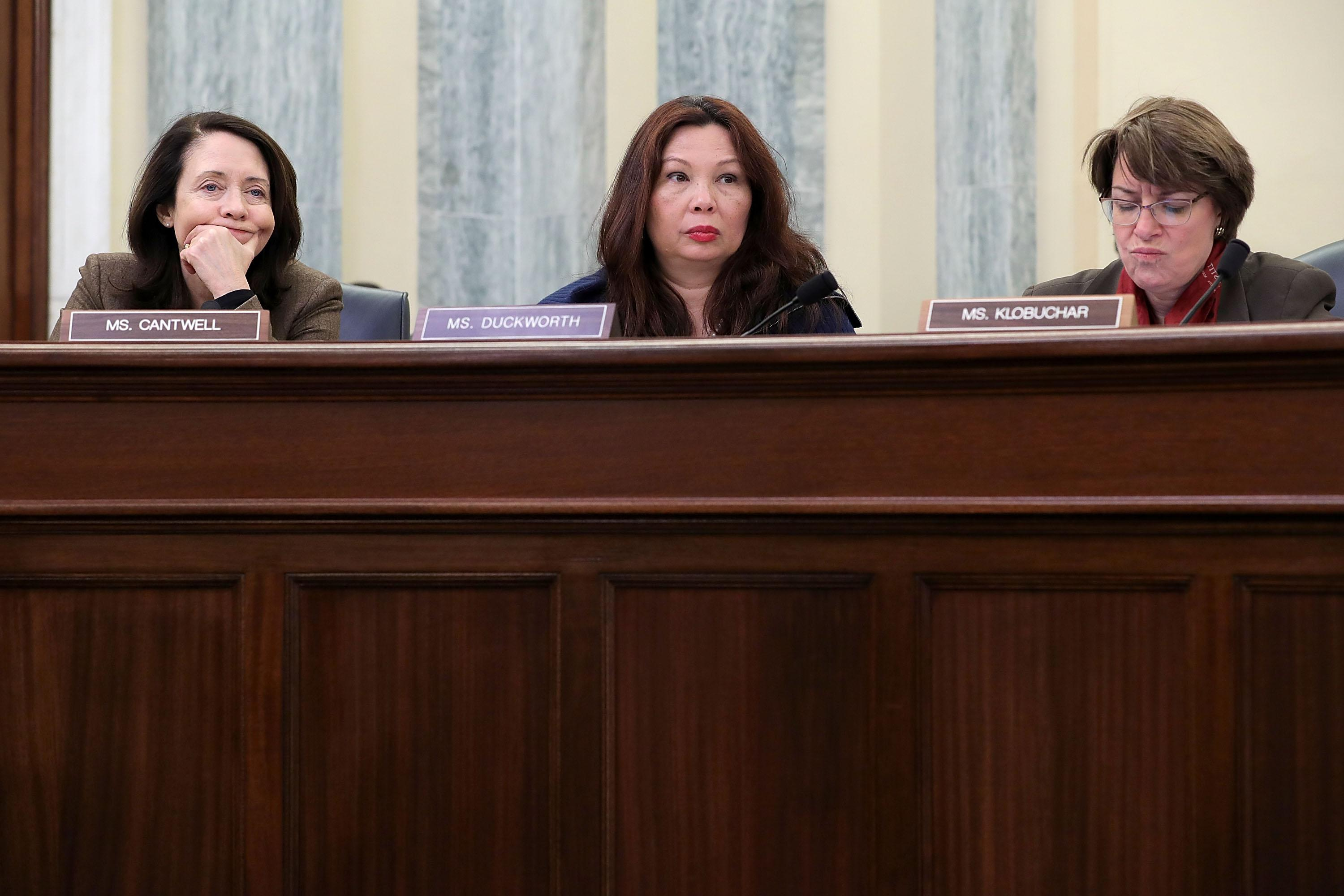 Senators Maria Cantwell, Tammy Duckworth, and Amy Klobuchar at a hearing