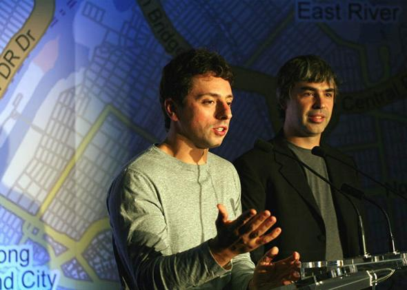 Google founders Larry Page (R) and Sergey Brin (L) speak at a press conference announcing Google's launch of a new transit mapping feature of Google Maps.